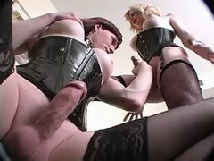 Two lustful shemales in black corset gets pleasure
