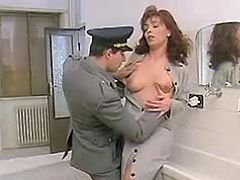 Hot redhead beauty seduces policeman in toilet