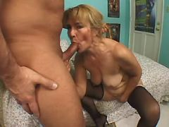 Granny in stockings throats cock of horny man